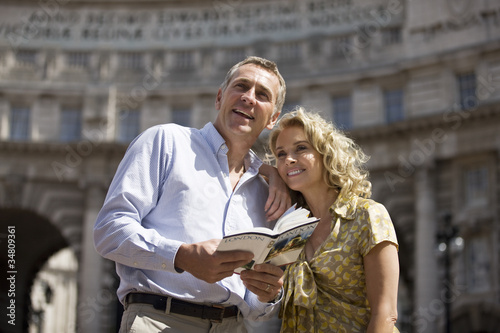 A middle-aged couple standing in front of Admiralty Arch