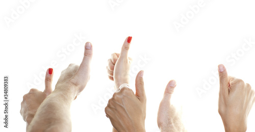Many thumbs in front of a white background showing up