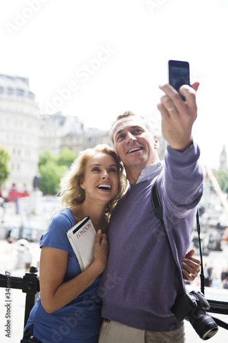 A middle-aged couple standing by Trafalgar Square
