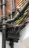 tangled wiring and guttering, pipes and electricals poster