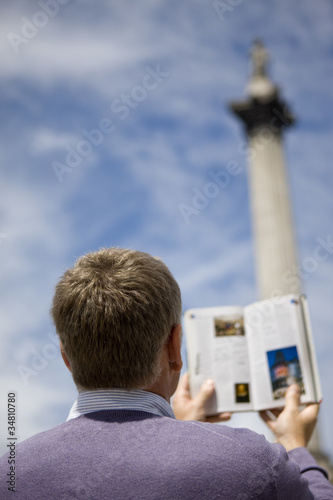 A middle-aged man in front of Nelson's column