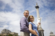 A middle-aged couple in front of Nelson's column
