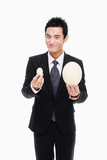 Businessman holding a big and a small egg