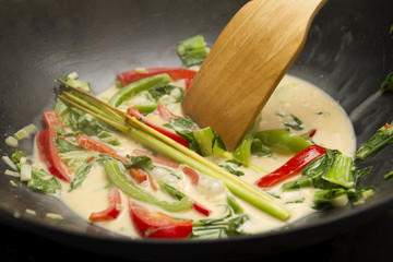 Spicy thai curry in wok