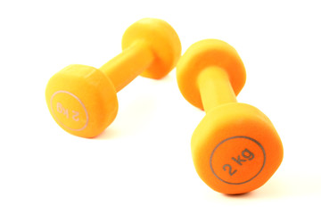 Pair of orange dumbbells isolated