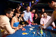 canvas print picture - happy friends playing roulette in a casino
