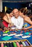 wealthy blackjack player flirting with two women poster
