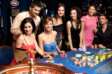 happy people excited about roulette bet outcome