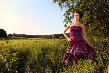 Beautiful girl in dress on field
