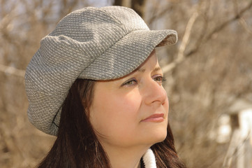 Young woman  profile with a cap