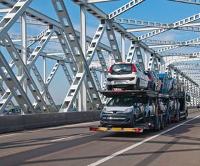 Car transport over an old Dutch bridge