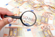 Fifty euro banknotes background with magnifier