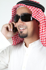 Portrait of a young arab man wearing sunglasses