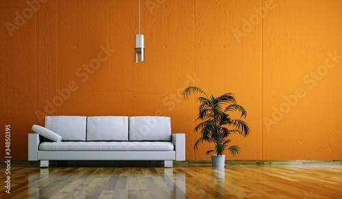 Wohndesign - weißes Sofa vor orangener Wand