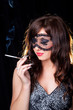 Smoking lady with lacy mask on black