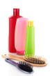 Shampoo bottles and hair brush on white