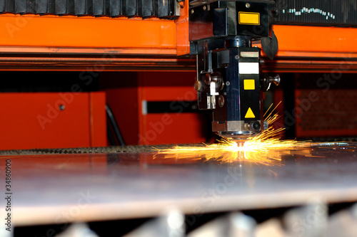 Industrial laser with sparks flying around