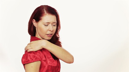 Woman massaging her aching back