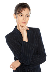 Portrait of young thinking businesswoman in suit