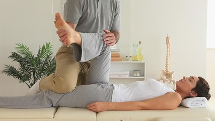 Chiropractor and woman doing special exercises