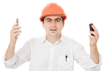 Crazy businessman in his helmet on the phone.