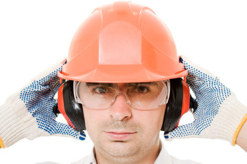 Businessman in a helmet on a white background.