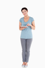 Dark-haired woman using a tablet computer