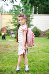 Young girl with pink backpack ready for school