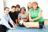 Teacher with CPR Class and Dummy poster