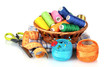 bright threads in basket, scissors and measuring tape