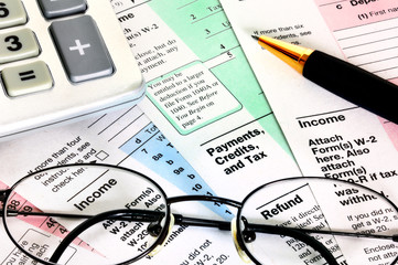 Business concept, financial papers with calculator, glasses and