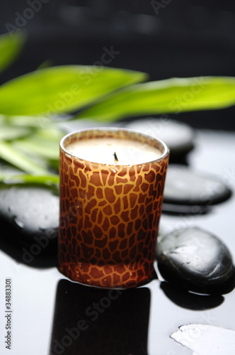 Aromatherapy candle burning with stones in a spa