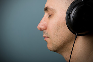 Man with ear-phones. Intimate portrait.