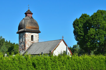 Old rural church in Scandinavia on a sunny day