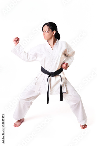 Karate woman in defence position isolated on white