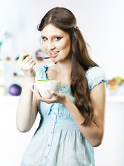 Beautiful girl eat in the kitchen
