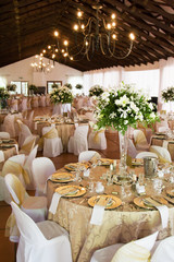 Wedding reception hall with laid tables
