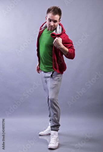 Modern style dancer posing behind studio background