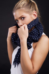Photo of beautiful woman with blond hair and scarf.