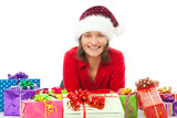 woman with chrsitmas hat between many colorful gifts