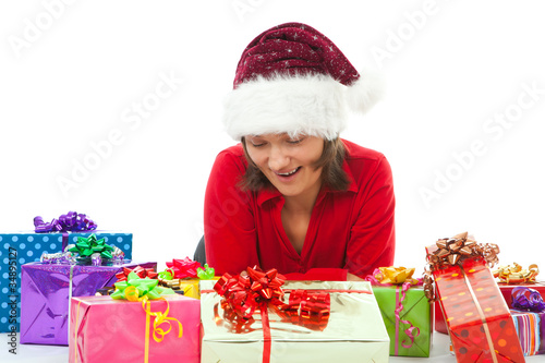 woman with christmas surprised between many gifts