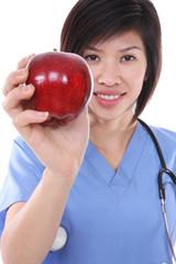 Pretty Asian Nurse with Apple