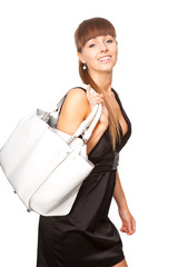 portrait of a beautiful woman in a black dress with a white bag