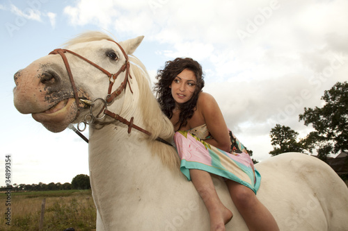 girl on a horse at day time
