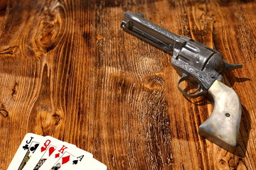 Cards and colt on a wooden desk