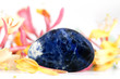 Sodalite gem stone with blossoms of Lonicera japonica
