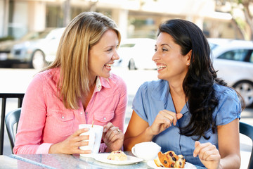 Women chatting over coffee and cakes
