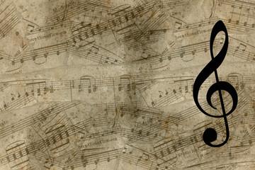 Chaive di violino su antichi spartiti musicali