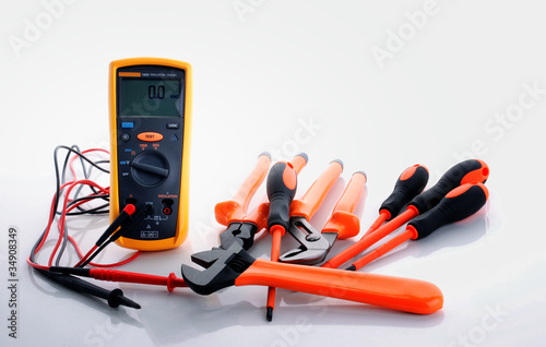 digital insulation resistance tester, screwdriver, wire cutter,