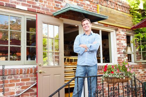 Man standing outside bakery/café